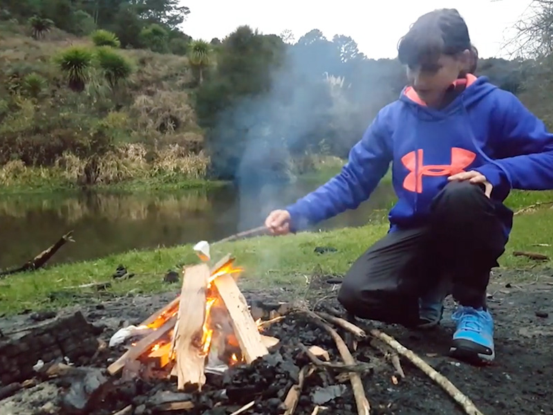 Toasting Marshmallows on the Kayaking Glow Worms Tour