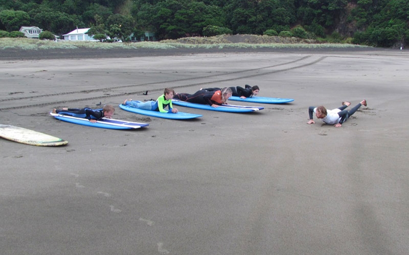 Learning to surf at Piha Beach Auckland